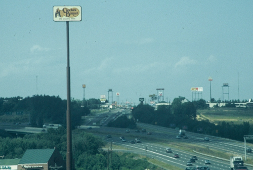 Signs along an interstate advertising to airplanes, rather than people.
