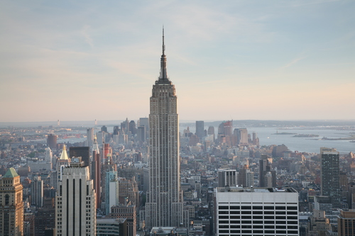 There is no chance that the Empire State Building will be abandoned because the street in front of it can't be maintained. You can't say the same about your suburban tract house.