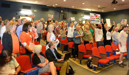 At the meeting in McHenry, Gabe Echeverri asked all who supported a ban to stand.
